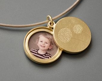 golden double locket with delicate dandelions