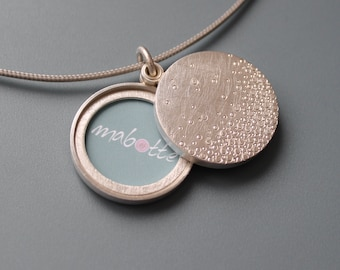 Modern double photo locket in sterling silver with bubbles design