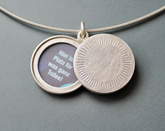 Minimalist silver locket for two pictures with aureole