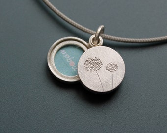 small silver double locket with delicate dandelions