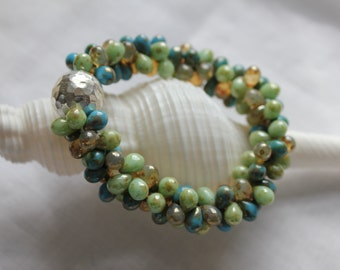 summer pebbles . double drops glass and sterling silver hammered focal bead bracelet