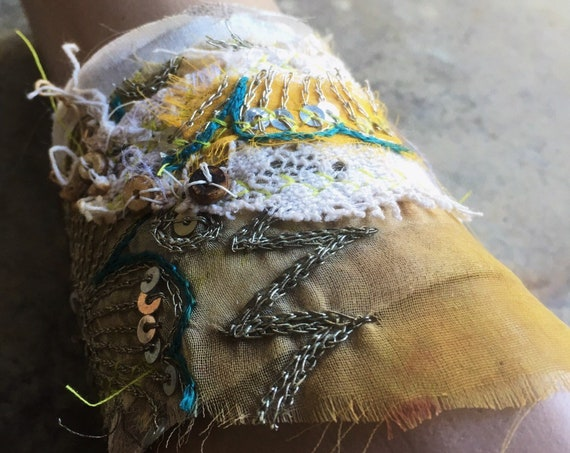Boho embellished suede cuff   taupe colored suede with tattered textiles, sari silk, vintage lace (adjustable)