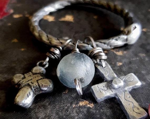 Ouroboros bangle | Sand cast ouroboros charm bangle with cross and African glass