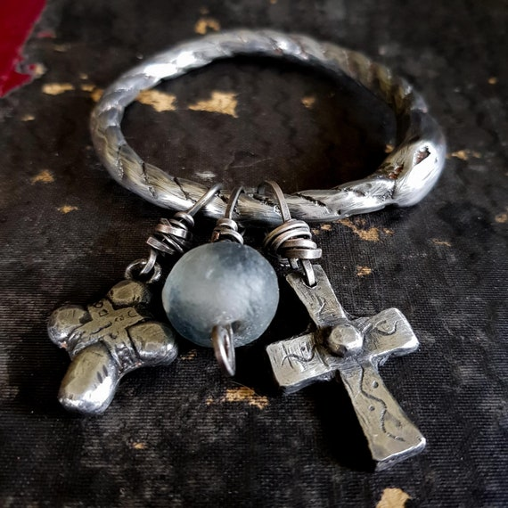 Ouroboros bangle | Sand cast ouroboros charm bangle with cross and African glass