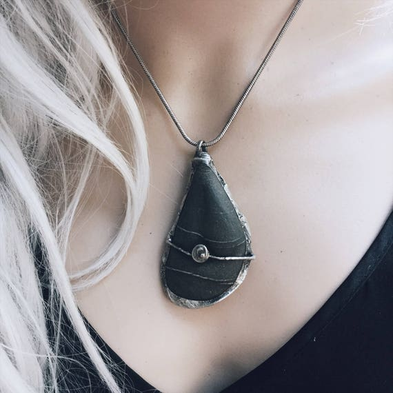 Zen stone Necklace | natural dark gray beach stone pendant in a rustic silver setting