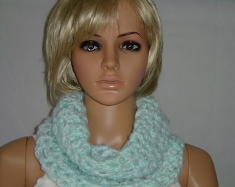 Crochet close fitting ladies cowl in a pale turquoise shade