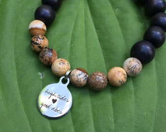 Laser engraved High Tides Good Vibes stainless steel charm on wood bead and jasper mala meditation bracelet unisex