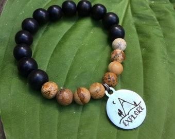 Laser engraved Explore stainless steel charm on wood bead and jasper mala meditation bracelet unisex