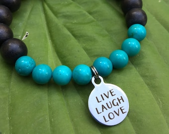 Laser engraved Live Laugh Love stainless steel charm on wood bead and turquoise mala meditation bracelet unisex