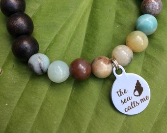 Laser engraved The Sea Calls Me stainless steel charm on wood bead and amazonite mala meditation bracelet unisex