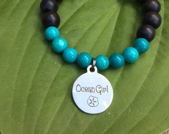 Laser engraved Ocean Girl stainless steel charm on wood bead and turquoise mala meditation bracelet unisex