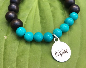 Laser engraved Inspire stainless steel charm on wood bead and turquoise mala meditation bracelet unisex