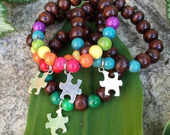 Yogi inspired wood bead meditation bracelet with autism puzzle charms and accent beads for autistic children kids men women