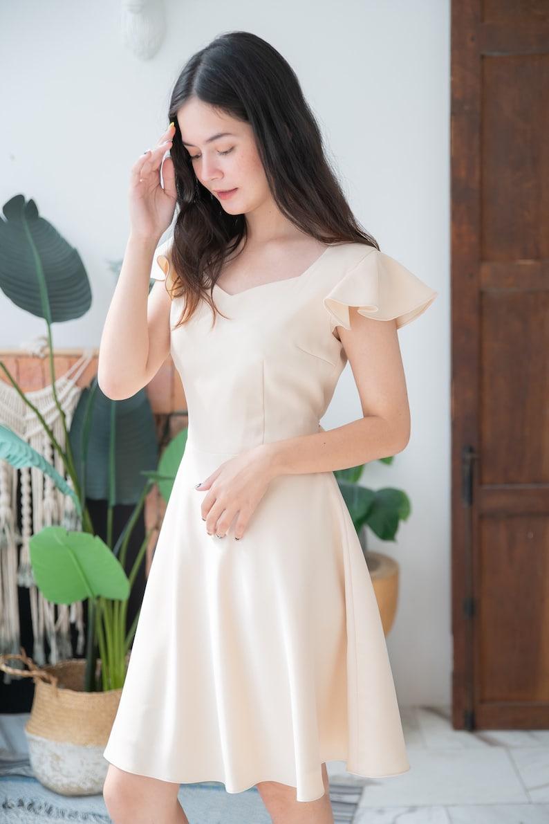 Cream Dress Ruffle Sleeve Fit and Flare Bridesmaid Dress Swing image 0
