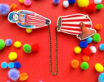 The amazing human cannonball double brooch