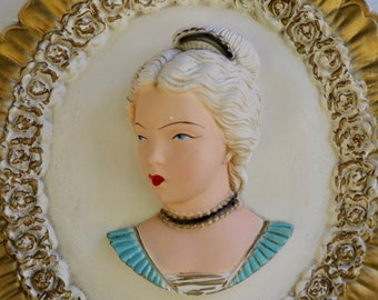 STUNNING Chalk ware bas-relief Female Face Sculpture.Victorian Era Style with Flowers and Gold Border.Retains Deep Bright Colors. 1940s