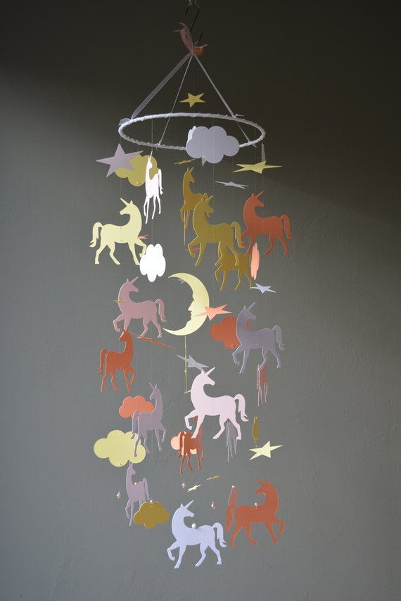 Unicorn nursery mobile or baby mobile made from light pink, light orange, yellow and white card stock --- Unicorn decor or nursery decor