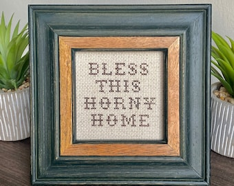 Bless This Horny Home - framed cross stitch (green frame)