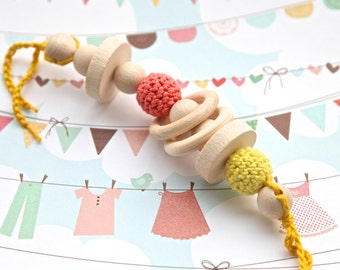 Teething rattle for baby. Natural wooden toy with crochet beads. First baby toy