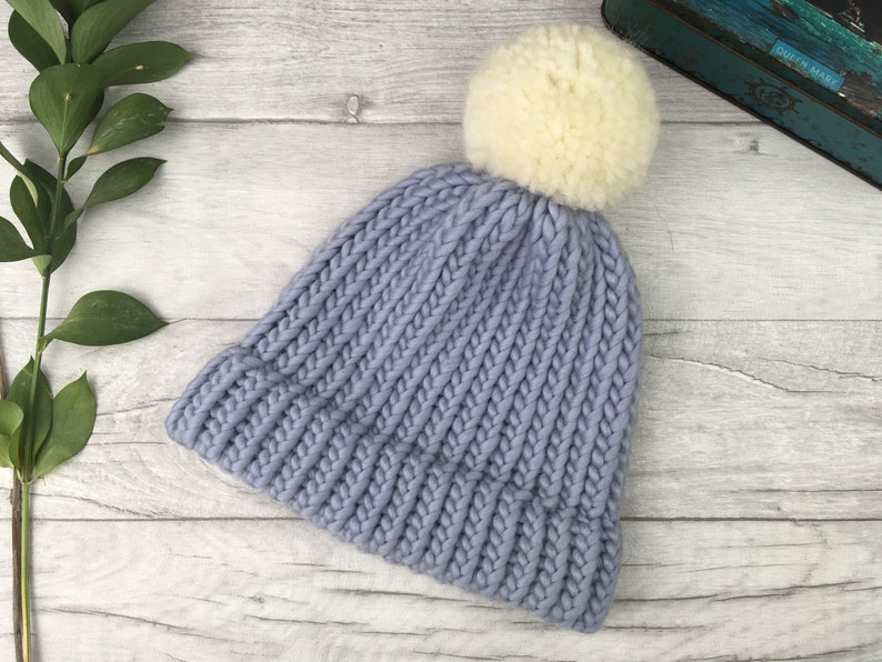 615991765ab5a9 Pale blue knitted pom pom hat made from pure wool matching | Etsy