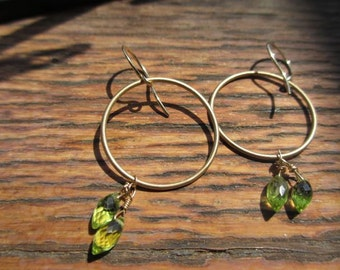 Gold circle hoop earrings with small leaf-shaped peridot stones 22083