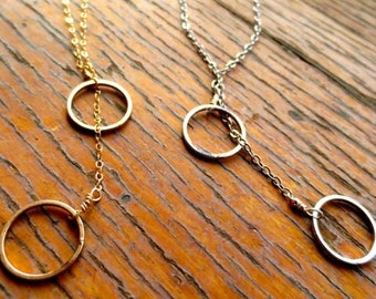 18 inch lariat with Rhodium, rose gold and/or gold circles necklace 34007