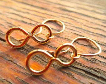 Golden infinity sign earrings 22090