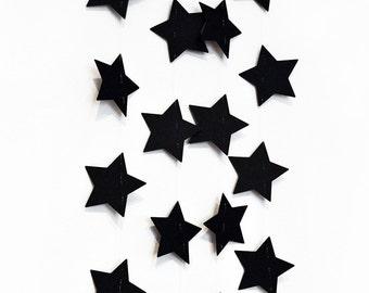 Black stars garland in cardboard