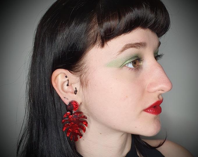 Beautiful Deep Red Acrylic Statement Monstera Leaf Earrings for pierced ears.