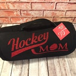Hockey Mom Fleece Roll Up Blanket. Comes in several colors, perfect for those cold ice rinks!