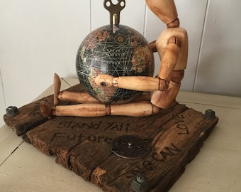 The Unknown assemblage piece political art altered art doll and distressed wood