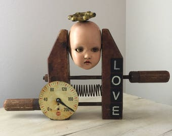 Assemblage art altered doll head unbreakable found objects  Unbreakable is a OOAK art doll