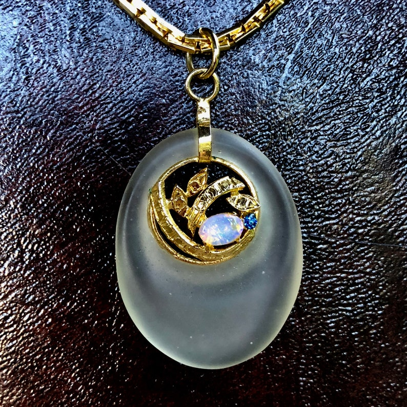 Vintage Gold Tone Frosted Oval Glass Pendant Necklace Translucent Faux Opal Rhinestone Jeweled Openwork Design Inset Pendant