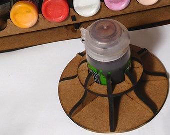 Paint pot holder, anti-tip device