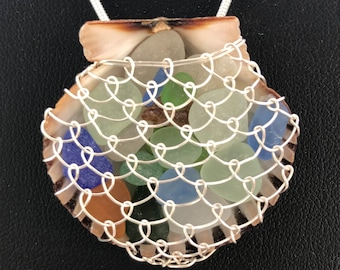 scallop shell filled with sea glass.
