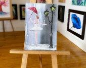 Dollhouse miniature Ballerina painting dancing in the rain