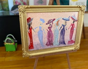 Dollhouse miniature Ladies painting.  Dressed in beautiful gowns and hats.