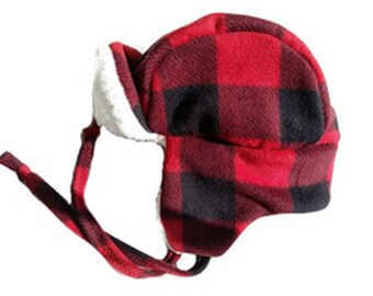 70684197cc0ba4 Winter trapper hat for adults in a buffalo plaid with cream colored sherpa  lining to keep you warm. Fits up to 25
