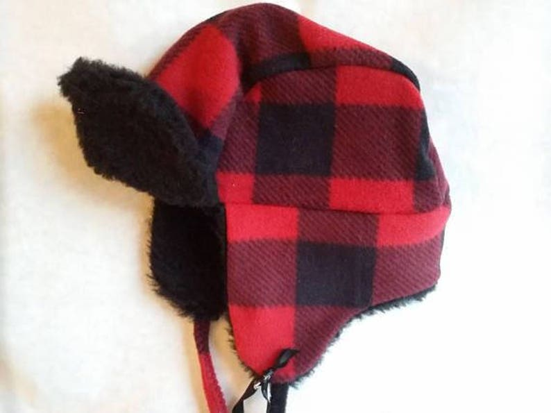 c18754bdfa1 Buffalo plaid toddler trapper hat fits up to 18 inches around.