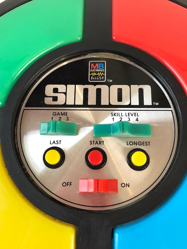 Vintage 80s SIMON Electronic retro memory computer controlled game toy rainbow nostalgic birthday gift light up primary colors electronics
