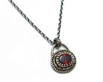 Distressed Sterling Silver Claw Set Faceted Oval Garnet Gemstone Pendant Necklace With Beaded Detail
