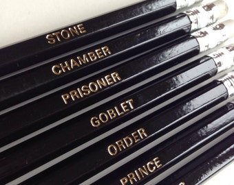 Harry Potter Pencils. Set of 7 pencils with book names foil printed in gold.