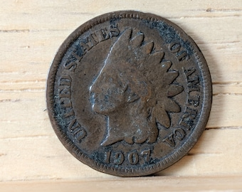 1907 Indian Head Pennies - two coins