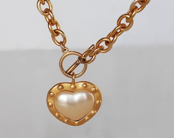 Mother's Day Sale price 24 dollars, 2-sided faux pearl heart,  in gold tone metal , suspended from gold tone chain, gift
