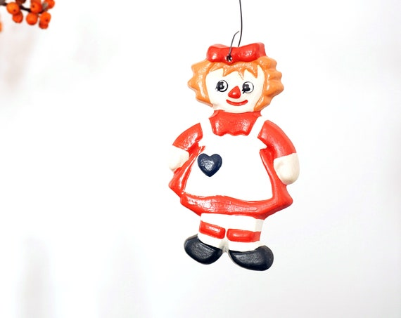 Vintage Raggedy Ann Ornament Hand Painted Clay Cookie Shaped Christmas Tree Ornament 1970s Ginger Hair Doll Red White Dress Black Heart