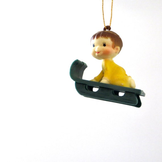 Vintage Sled Ornament Baby on Sled  Plastic Green with Yellow Boy Ornament Kid Sledding 1970s Christmas Tree Trim Small Boy Brown Hair