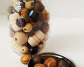 80 Assorted Loose Wooden beads with a variety of shapes.