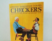 Old Skor-Mor Checkers. Has Hardwood Turned Checkers including playing board and strategy book