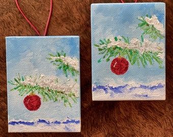 Evergreen bough, snowy mountains and sparkling Christmas tree ornament, glittering snow