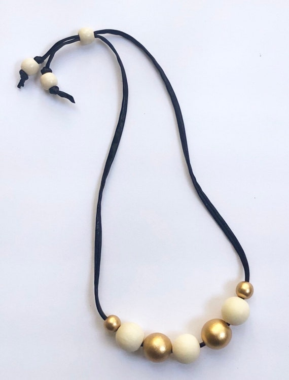 Short Black Metallic Jersey Cord + Round Gold/Off White Wood Bead Necklace